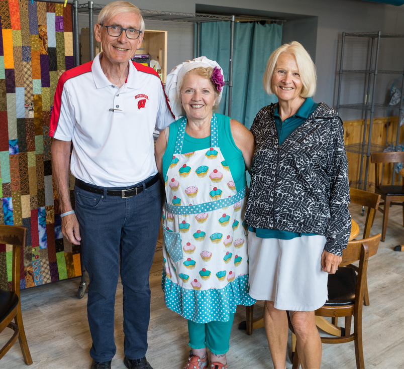 Pictured are Governor Tony (left) and Kathleen Evers (right), along with bakery owner Kathleen Ludwikowski (center) during a stop at Kathleen's Flour...